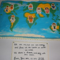 World Map Cake For International Day hand painted multi- cultural figures