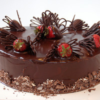 Triple Chocolate And Strawberry   Chocolate mud cake filled with chocolate buttercream, iced in chocolate ganache, chocolate covered strawberries..