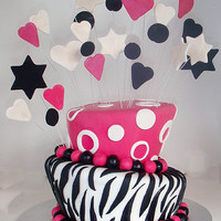 Stars Stripes And Spots   two tier topsy turvy cake..choc mud filled with chocolate butter cream..covered in fondant..