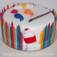Art And Craft  Chocolate mud cake filled with chocolate butter cream, covered in fondant, decorated in hand made fondant crayons, paint tubes, paintbrush...