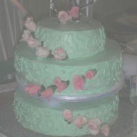 Wedding.jpg Made this for a friend's wedding. First time working with gumpaste and tiers. Turned out ok for never being trained i guess.