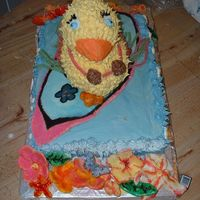 Duckcake.jpg fondant surfboard, flowers and shells. regular white cake mix for cakes. Used wilton duck mold for duck.