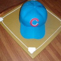 "Cubs Hat Cake Made this for my hubby's birthday. My first attempt at a 3d cake. Followed ""Confetti Cakes"" instructions but personalized it..."