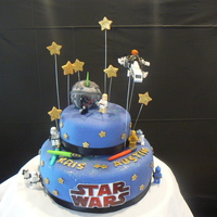 Star Wars Lego figuresplaces around fondant death star ( styrofoam ball covered in fondant) Fondant stars,edible glitter or luster dust.