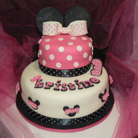 Minnie   Got my ideas for this one from looking on this site! I had the most fun making this one. Fondant ears, bows, lettering.