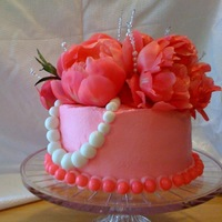 Pink Peonie Cake This is a cake I made for a womens brithday The white strand is a pearl necklace. It's zebra inside!!!