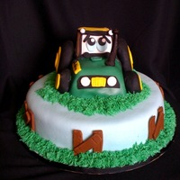 John Deere 2Nd Birthday Cake I made this cake for a 2nd birthday. It is chocolate cake with chocolate buttercream with a combination of homeade fondant (not mmf), MMF,...