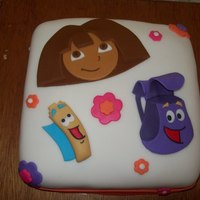 Dora The Explorer Cake Dora cake for my niece. Dora, Map, and Backpack made from fondant.