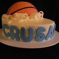 Basketball Cake Chocolate cake, oreo cream filling, buttercream icing with fondant accents. Ball is rice krispies covered in fondant.
