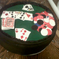 Poker Game Cake All covered with fondant. The chips and cards are also fondant, I drew the design on the cards with a edible marker. I also drew on the...