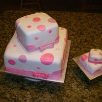 Pink Polka Dots With Smash Cake This was for a one-year old's birthday so they wanted a smash cake that was just like the big cake. This was my first attempt at using...