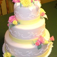 Pink And Yellow Roses Wedding cake with gumpaste/modeling clay roses and calla lillies.