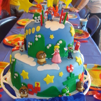 Mario Cake This was my first fondant cake. I made it for my son's 9th birthday.