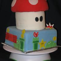 Super Mario This was a cake for my nephews 7th birthday. i had one day to make it so I called a friend and we got it done! I LOVE this cake! It was a...