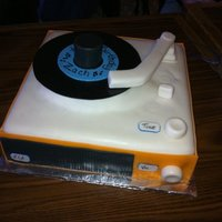Retro Record Player I saw this cake here on CC and I had to make it for my brother in law. He loved it! The arm swiveled and the record was not attatched.
