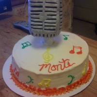 Karaoke B-Day Cake 2 layer buttercream frosted carrot cake with rkt microphone covered with fondant.
