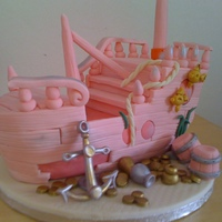 Pirate Ship made this for my daughters 14th........ not exactly a girls cake but the colour certainly turned it into one..... its not just a mans world...