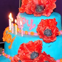 Zephyr's 7Th Bday Cake  these are gumpaste poppies on my daughters 7th birthday cake, its not my best fondant work cause I was in a huge rush, and the poppies...
