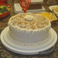 Italian Cream Cake For Cindie  italian cream cake made with walnuts and coconut inside the cake, and with toasted coconut and almonds on top with cream cheese icing! yum...