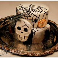 Kyle's Groom's Cake Fondant covered with gumpaste gun and hand sculpted skull. Groom drew picture of what he wanted on his cake. Added the USMC medallion as a...