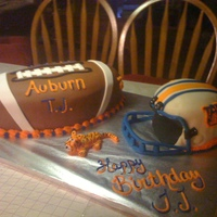 Aurburn Football And Helmet Cake It took me two days to make this but it turned out great. This was my first real attempt at sculpting a cake. Football is made out of three...