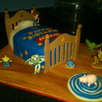 Toy Story Bed I made this Toy Story bed for a friends little boy. He was turning three and adores Toy Story. The blanket and rug are fondant as well as...