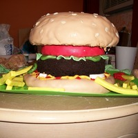 "Hamburger The bun is vanilla cake covered in marshmallow fondant and rice-crispy cereal ""seeds"". The burger itself is a ""naked"",..."