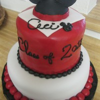 Mickey Mouse Graduation Cake  For my friend Ceci, who graduated from college. Bottom tier is chocolate with raspberry filling, top tier is vanilla with chocolate...