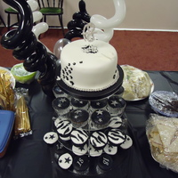 Black & White 18Th Birthday White chocolate and lemon cupcakes and white chocolate chip top tier cake, iced and decorated in fondant and gumpaste.