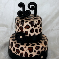 "Leopard Print Birthday! I made this cake for my sister's 19th birthday. 9"" and 6"" cake. All fondant with hand painted leopard print. Flower is..."
