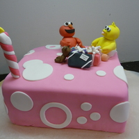 Sesame Street Birthday Made for my baby on her first birthday. Everything including candle is fondant or gumpaste except the safety pin which is gold wire....