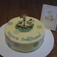 Baby Giraffe Baby shower cake made to match the invitation. The giraffe was molded from fondant.