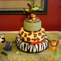 "Jungle Animal Cake Three-tier cake (12"", 9"", and 6""). Zebra print on bottom, giraffe on middle and hand sculpted tree on the top tier."