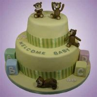 Baby Bears Fondant covered cake with hand molded baby bears. This was a surprise cake for a baby shower.