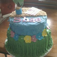 Beach Birthday Two tier iced in buttercream with fondant accents. Beach is made of brown sugar.