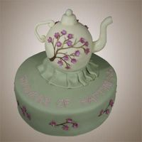 Teapot Cake  This cake was made for a friends bridal shower. The shower had a tea theme. The cake is covered in fondant and the cherry blossom design is...