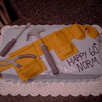 Tool Belt Lemon raspberry cake with buttercream icing.Fondant molded tools.