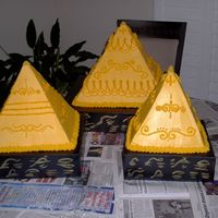 Pyramid Cakes Gold buttercream pyramid cakes. I made these for my friends Egyptian themed wedding.