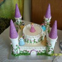 Princess Cake Done in Buttercream ,trim with royal icing hearts and towers covered in fondant.