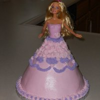 Barbie Cake Carved from two 8 inch cakes and 1 6 inch cake. buttercream skirt. fondant bodace