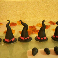 Halloween Cupcakes I made these for my kids halloween parties. The kids LOVED them. I had inspiration for the hats from many other CCers. Thank you!