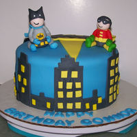 Batman And Robin Tiny Titans Style Batman cake for a little boy. He really thinks he's Bruce Wayne. I got the idea of the buildings from many other Batman cakes here on...