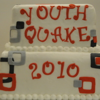 Youth Worship 2010 Yellow cake filled and covered with white almond buttercream. Decorations are made out of fondant.