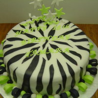 Zebra Birthday The Birthday girl requested a Zebra cake with Lime Green letters. This is a chocolate cake with cream cheese filling. The outside is...