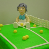 Time To Hang Up The Racket Old Timer!! Over the hill birthday for a tennis lover. Yellow cake covered in buttercream. Details and lady are made a gumpaste / fondant mixture.