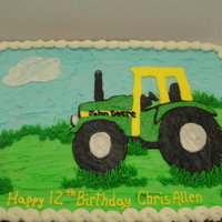 John Deere Birthday boy requested a John Deere cookie cake. Chocolate chip cookie cake covered and decorated with butter cream icing.