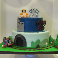 Thomas And Spiderman Cake was chocolate and vanilla with vanilla BC filling and covered with marshmallow fondant. Figurines were gumpaste and accents were all...