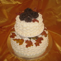 Wilton Tall Cakes Class The tiered cake I made in the Tall Cakes class. Ivory basketweave with chocolate roses and gumpaste leaves/acorns.