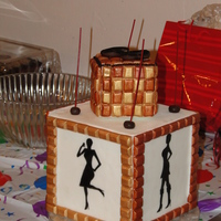 A Model's Sassy 60Th Birthday Cake!   Fondant decorations and the silhouettes were made using an edible marker.