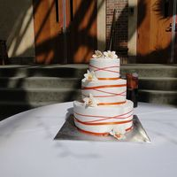 Orange Orchids  Orange gumpaste orchids adorn this buttercream cake. The entire cake was marble vanilla bean and chocolate fudge with Bavarian cream...